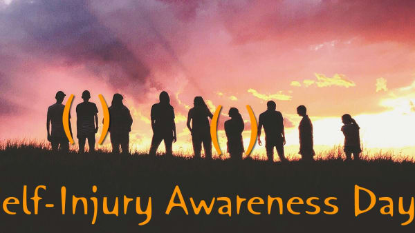 A line of people silhouetted against a sunset, with the text Self-Injury Awareness Day