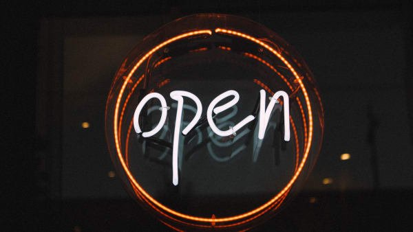 A neon sign that says open